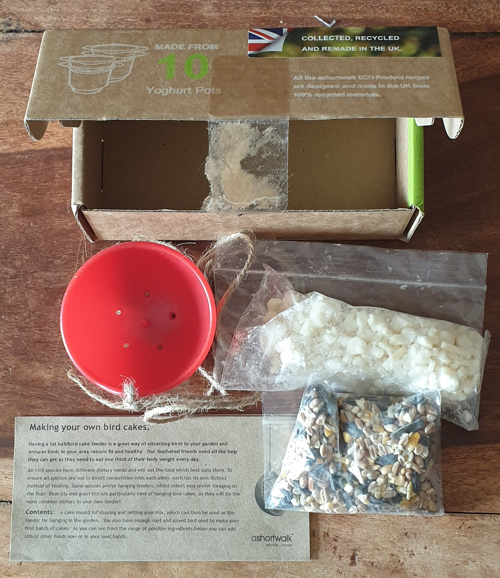 Picture of a birdfeeder kit made from recycled yoghurt pots