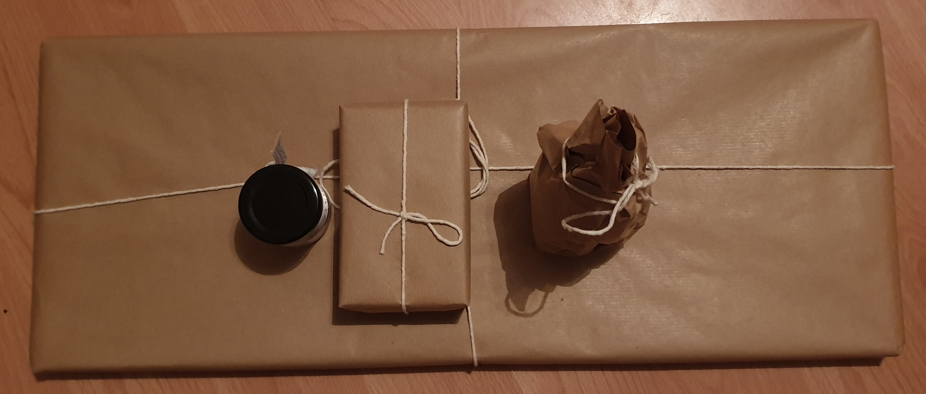 Picture of gifts wrapped in brown paper